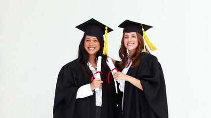 Happy graduated students talking to each other