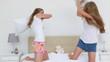 Joyful women having a pillow fight