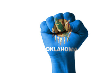 Fist painted in colors of us state of oklahoma flag