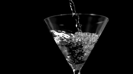 Liquor being poured in super slow motion