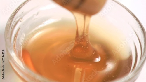 Honey in a bowl in super slow motion