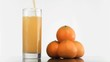 Orange juice in super slow motion filling a glass