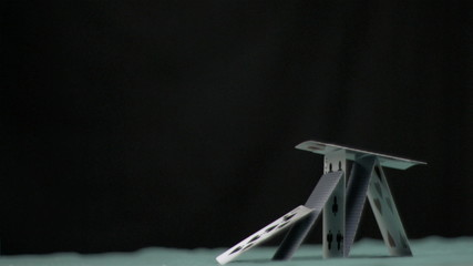 Pyramid of cards collapsing in super slow motion