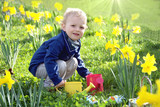 Blond child watering plants