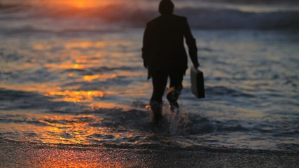 Businessman plunging into the sea