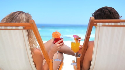 Couple holding cocktail
