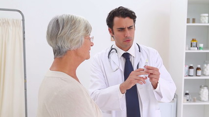 Doctor going to give an injection to a patient