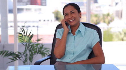 Happy well-dressed woman on the phone