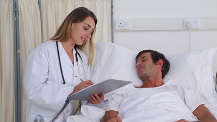 Doctor talking to a patient in his bed