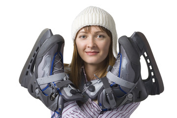 Happy young woman with ice skates