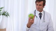 Doctor taking a green apple