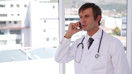 Doctor calling with a mobile phone