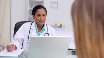 Doctor questioning  a patient