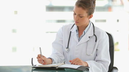 Medical doctor writing in her journal
