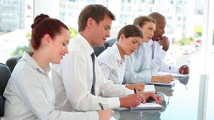 Business team taking notes in a meeting