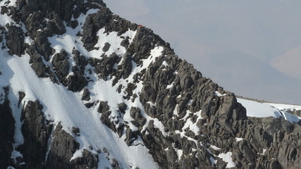 Climber on north face of Ben Nevis Scotland