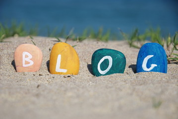 blog word painted over some pebbles