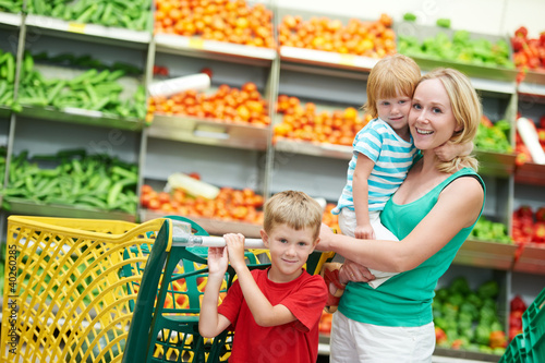 woman and boy making shopping