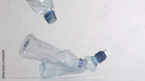 Crushed bottles in super slow motion dropping