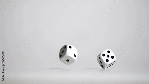 Pair of white dice in super slow motion bouncing
