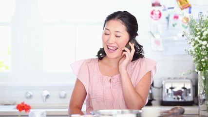 Woman happily talking on a phone