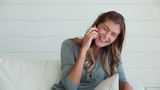 Woman laughing as she talks on a phone