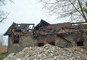 Burnt and collapsed house