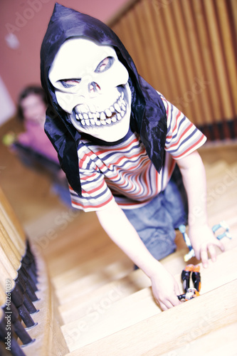 Boy wearing skull mask