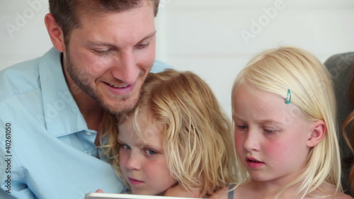 Family watching something on a tablet computer together