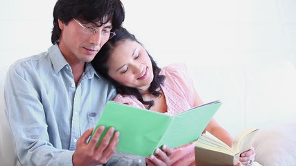 Man reading a booklet with a woman