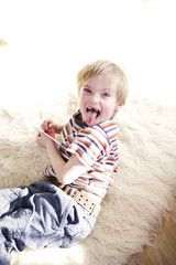 Boy lying on carpet, portrait