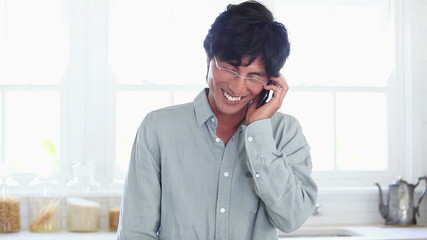 Man happily using a mobile phone