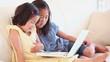 Two girls watching something on a laptop