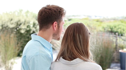 Brunette haired couple looking into the distance