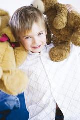 Boy holding toy, portrait