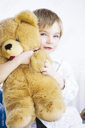 Boy holding toy, portrait