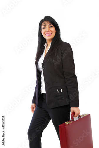 Dynamic businesswoman on the go with briefcase