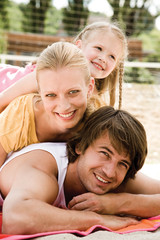 Girl with parents, smiling