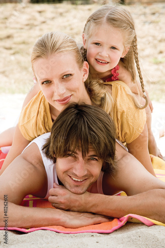 Girl with parents, smiling, portrait