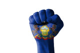 Fist painted in colors of us state of pennsylvania flag