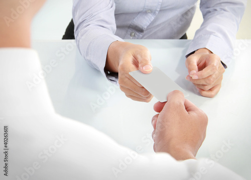 business people changing business cards