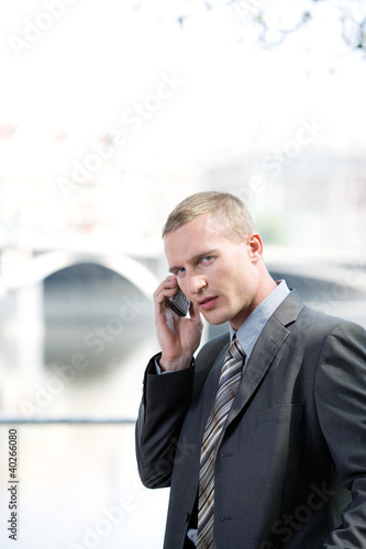 Businessman using mobile phone, portrait
