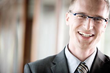 Businessman smiling, portrait