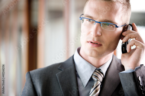 Businessman using mobile phone, close-up