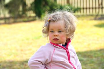 sweet little girl in the garden