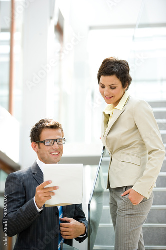 Business people looking at document