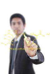 Teacher writing scientific formula on the whiteboard.