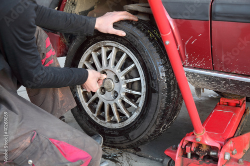 Automotive, mechanic working on a car tire in service