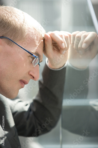 Businessman contemplating, portrait