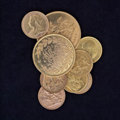 coins closeup, golden background